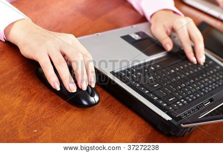 Hand with a computer mouse. Business lifestyle background.