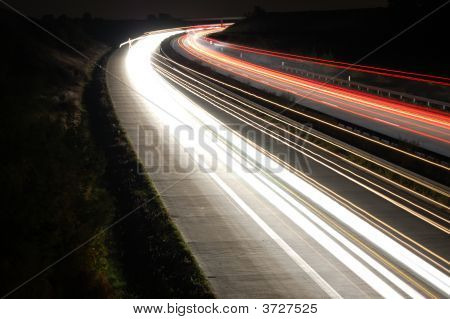 Highway At Night With Traffic