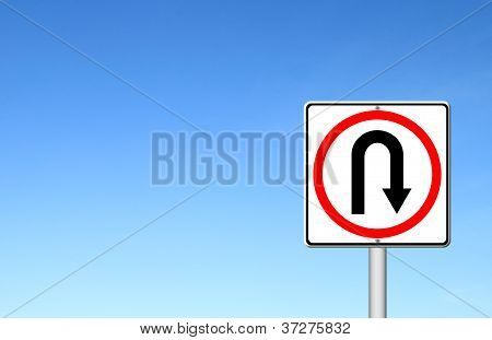 Turn Back Road Sign Over Blue Sky