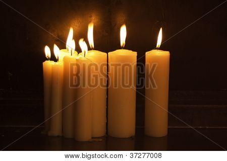 Burning candles in dark