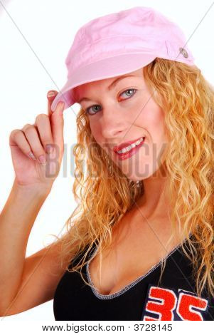 Young Woman Trying On Pink Sports Hat