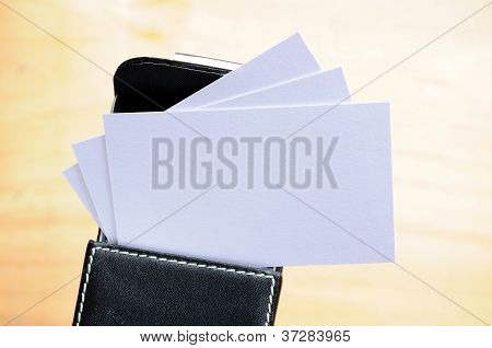 Business cards over wooden background