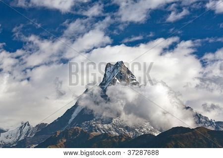 Peak Machapuchare Over Clouds