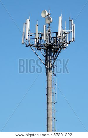 Telecommunications Antenna On Blue Sky Background