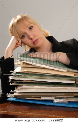 Businesswoman With Too Much Work