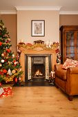 image of cozy hearth  - Christmas scene in a living room with copyspace - JPG