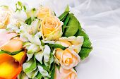 pic of yellow rose  - colorful wedding bouquet of fresh flowers against white dress background - JPG