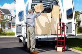 picture of movers  - Happy professional shipping courier - JPG