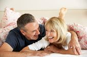 picture of pyjama  - Senior Couple Relaxing Together In Bed - JPG