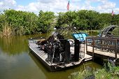 picture of airboat  - Air boats docked on a pier at the Everglades - JPG