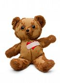 stock photo of broken hearted  - Tattered and tearful vintage Teddy bear with bandaged broken heart on white - JPG