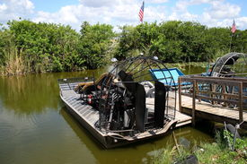 image of airboat  - Air boats docked on a pier at the Everglades - JPG