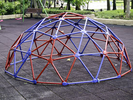 stock photo of geodesic  - Colorful geodesic dome in schoolyard or playground outdoor - JPG