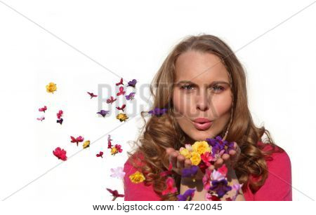 Happy Spring Or Summer Woman Blowng Flowers