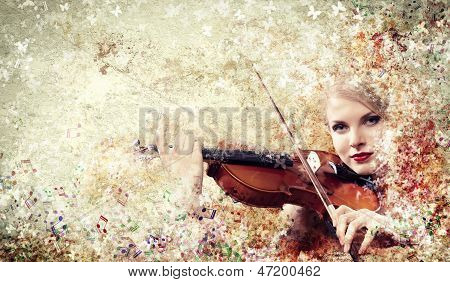 Gorgeous woman playing violin