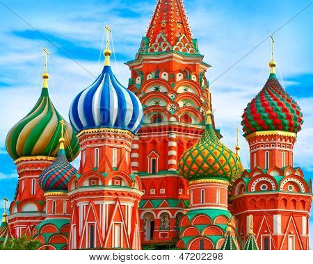 The most famous architectural place for visiting and attraction in Moscow, Russia, Saint Basil's cathedral with colorful cupolas and spectacular domes in traditional culture on cloudy blue sky