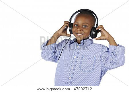 A handsome young elementary boy happily wearing a DJ's headphones.  On a white background.