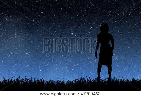 Woman under the night sky