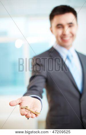 Hand of businessman holding key