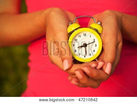 Woman Holding Alarm Clock