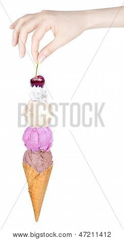 Three Scoops Of Ice Creams With Cone And Cherry