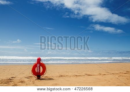 Lifebuoy on sea background