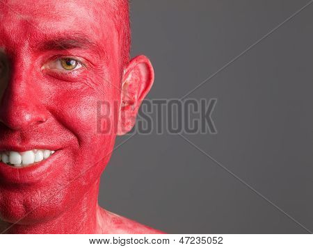 Man with Face Painted Red