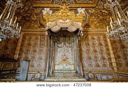 PARIS - APRIL 16: Royal bedroom with luxury apparels interior on April 16, 2010. The Versailles Palace is a royal chateau in Versailles in the ile-de-France region of France.