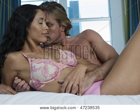 Passionate young couple in bed