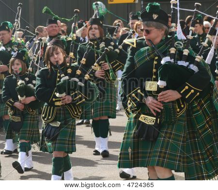 Irishmen In His Kilst Is Playing On Bagpipe During The St. Patrick's Day Parade.