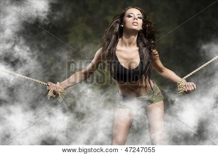 Tied Woman In Sexy Pose In Military
