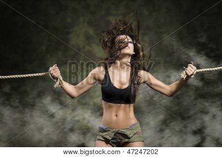 Strong Woman With Tied Wrists In Sexy Dress