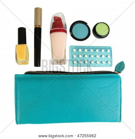 Hormonal pills in women's make-up bag isolated on white