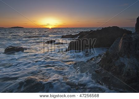 Rocky Beach With The Sun Rising