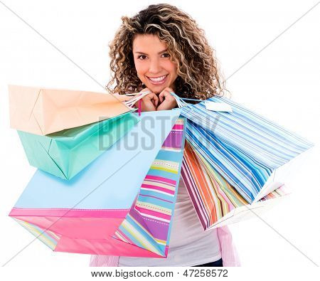 Beautiful shooping woman smiling - isolated over a white background