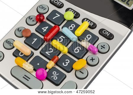tablets are on a calculator. symbol photo for costs in the medical and pharmaceutical industries