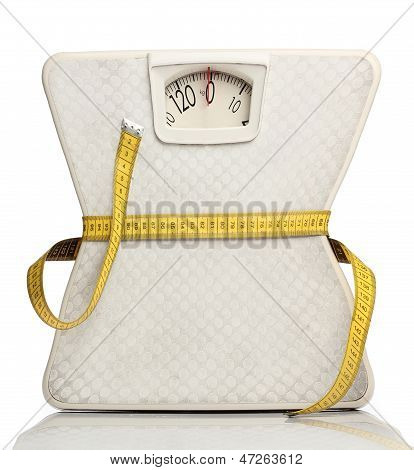 Weight scale with a measuring tape over white