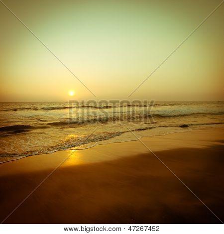 Beautiful Sunset At Tropical Beach. Ocean Sandy Coast Under Evening Sun