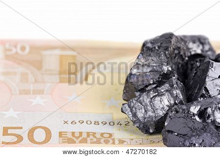 Fifty Euro Banknote Whith Raw Coal Nuggets On It