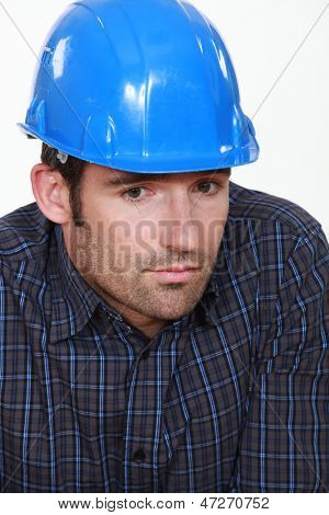 Portrait of tradesman lacking self-confidence