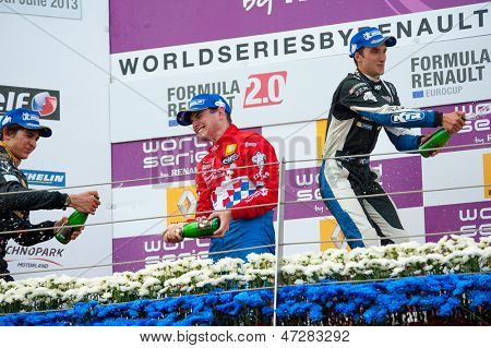 MOSCOW - JUNE 23: The winners of Formula Renault 2.0 race splashing each other with champagne at World Series by Renault in Moscow Raceway on June 23, 2013 in Moscow