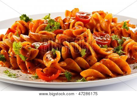 Pasta with meat, tomato sauce, parmesan and vegetables