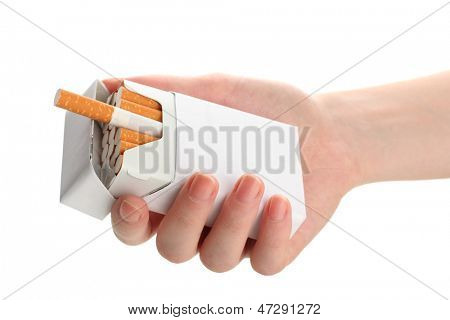 Woman hand with box of cigarettes, isolated on a white