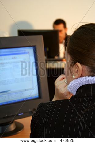 Businesswoman & Businessman - Working At Pc