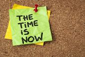the time is now - motivational reminder on a green sticky note