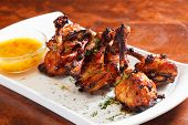 foto of grub  - Chicken wings with sauce - JPG