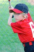 image of little-league  - Portrait of Little league baseball player holding a bat - JPG