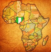 stock photo of nigeria  - nigeria on actual vintage political map of africa with flags - JPG