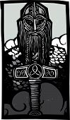 stock photo of thors hammer  - Woodcut style image of the Norse God Thor with his hammer against the sky - JPG