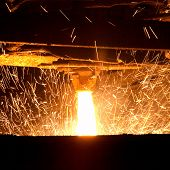 image of blast-furnace  - the close up view of Molten steel pouring - JPG